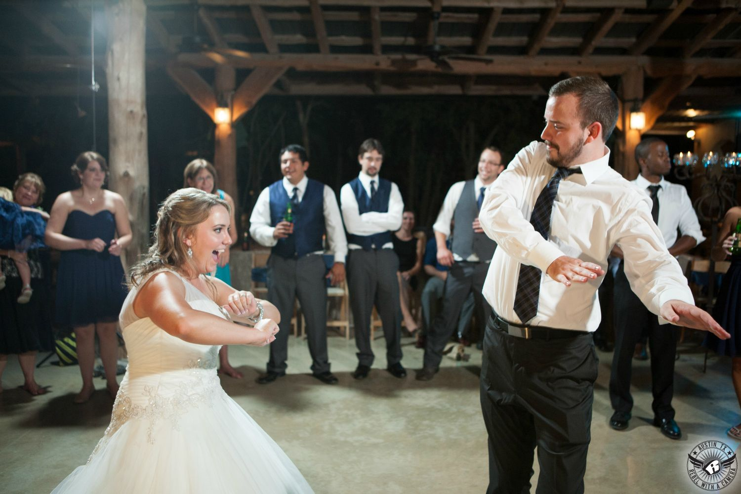 Wedding Picture Of Bride In Sparkly One Shoulder Gown And Her Brother Dance During The