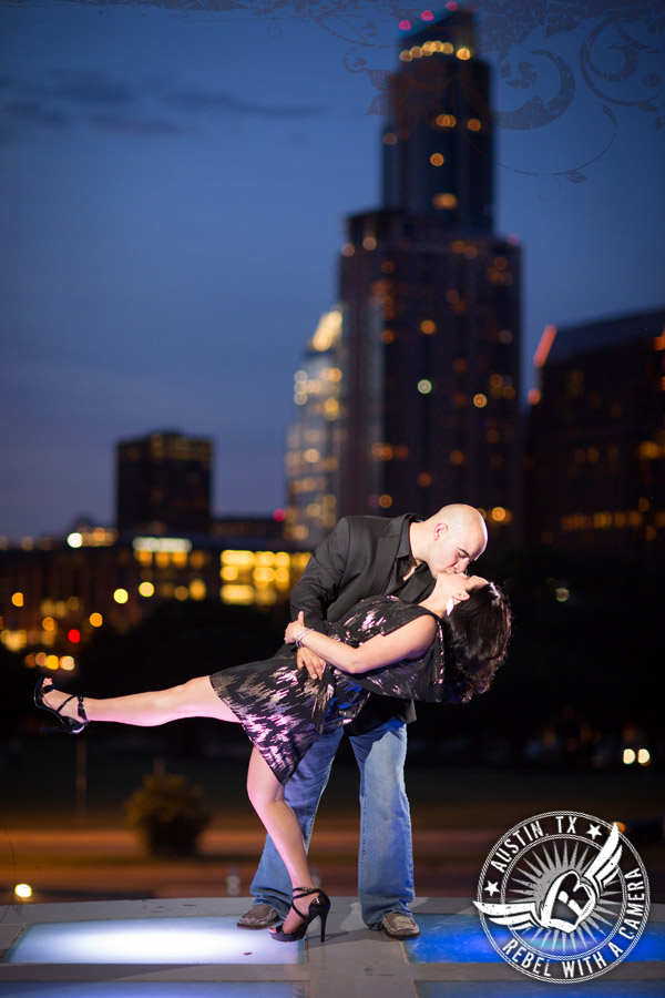 playful engagement photos at the long center austin with views of the downtown skyline