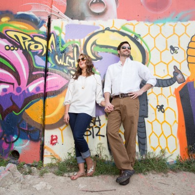 engagement couple at graffiti wall