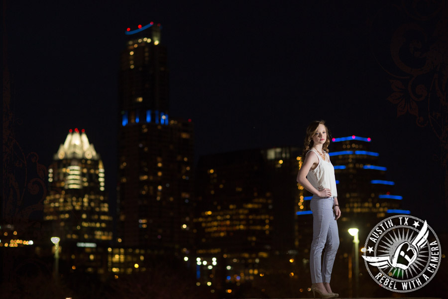senior portraits with the austin skyline at night