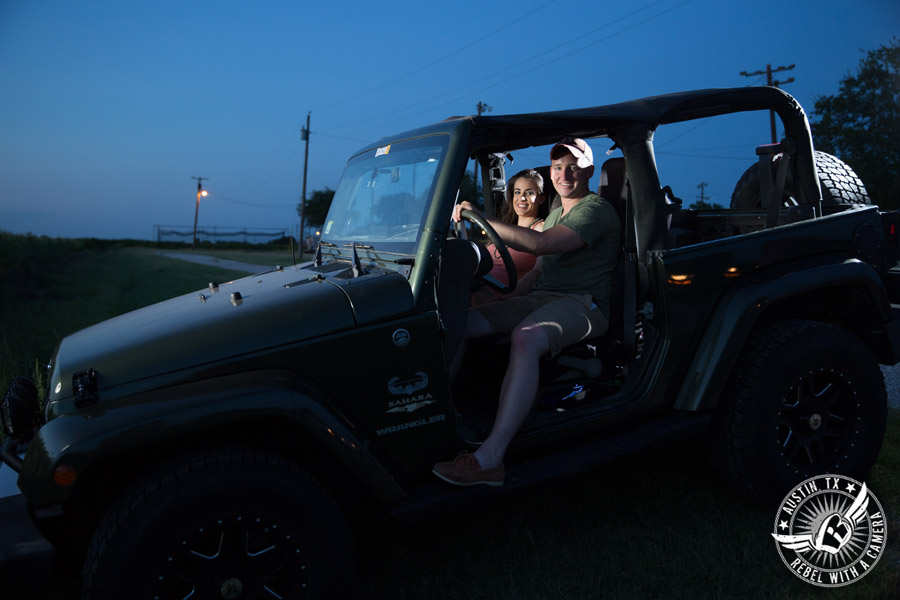 Army engagement session in Texas bride and groom in jeep on country road