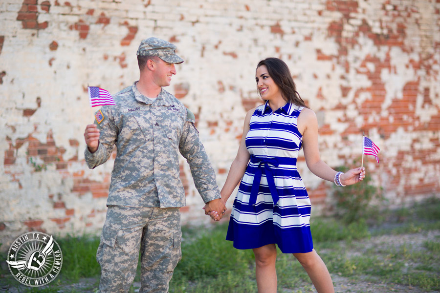 Army engagement pictures in Texas soldier and bride wave American flags