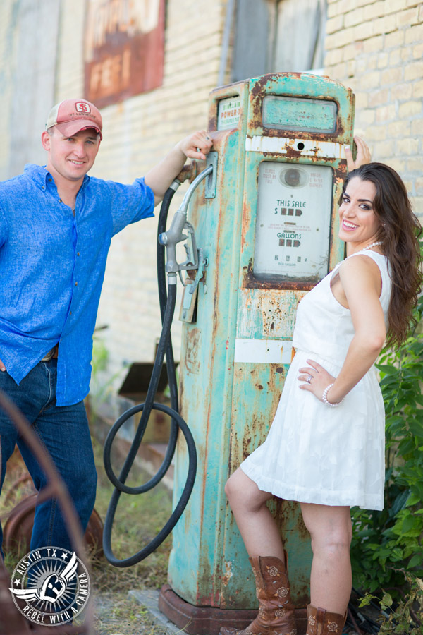 Army engagement session in Texas bride and groom with old gas pump in rustic country town