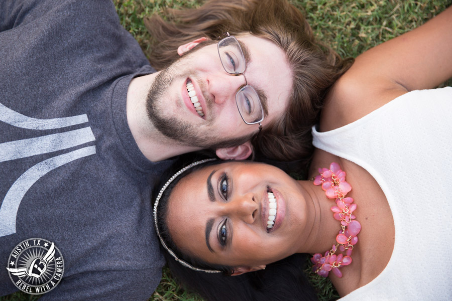 Fun Butler Park engagement session in Austin lying the the grass