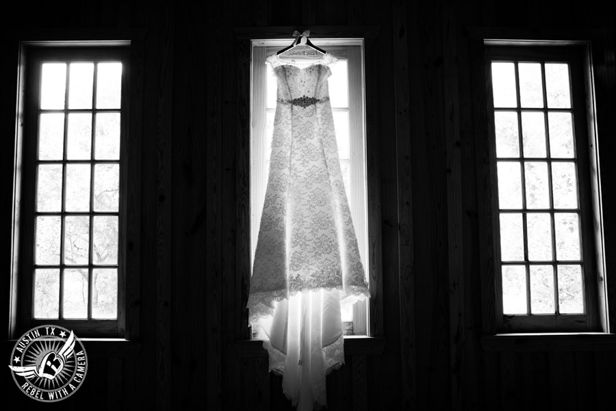 Sage Hall wedding photos at Texas Old Town wedding dress hanging in window