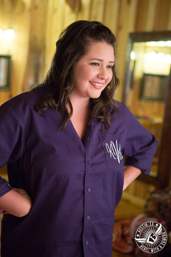 Sage Hall wedding photos at Texas Old Town bridesmaid in purple monogrammed shirt in bridal room