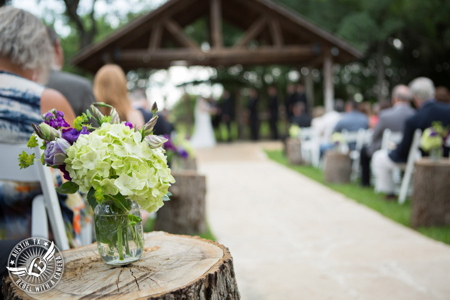 Sage Hall wedding photos at Texas Old Town green and purple floral aisle decor by STEMS Floral Design at wedding ceremony