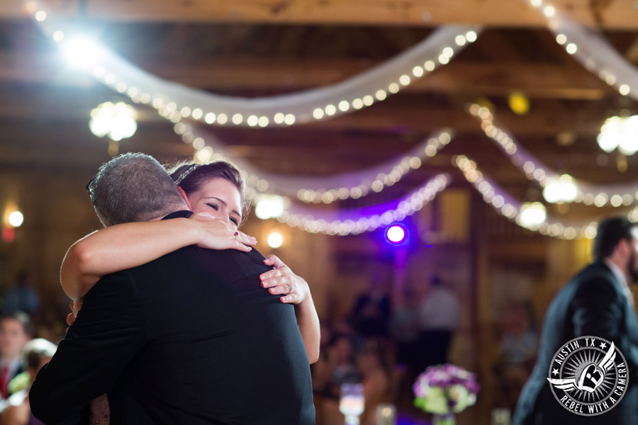 Sage Hall wedding photos at Texas Old Town bride hugs father during father/daughter dance at wedding reception