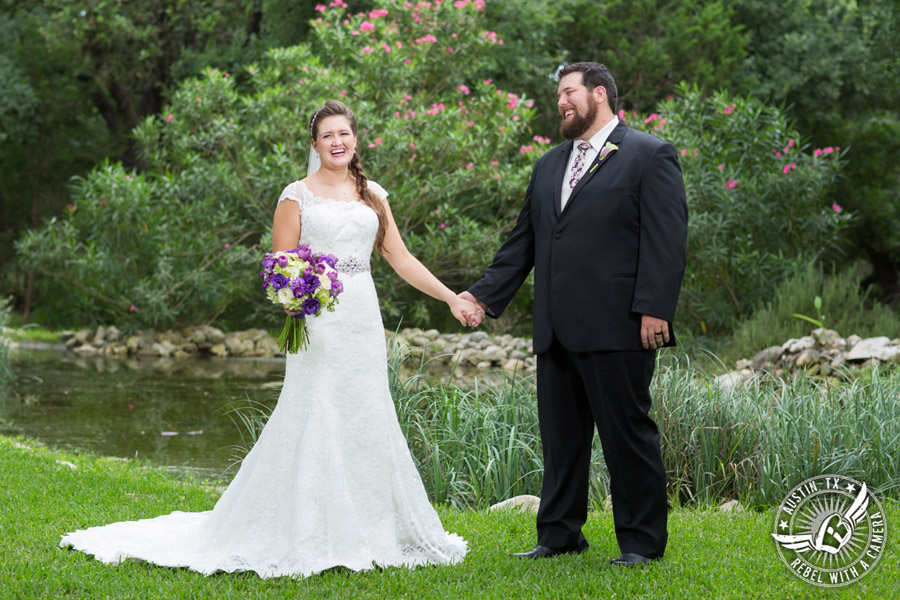 Sage Hall wedding photos at Texas Old Town bride and groom hold hands and laugh