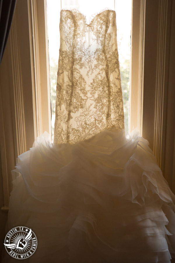 Picture of lace wedding dress hanging in window at the Driskill Hotel in Austin, Texas
