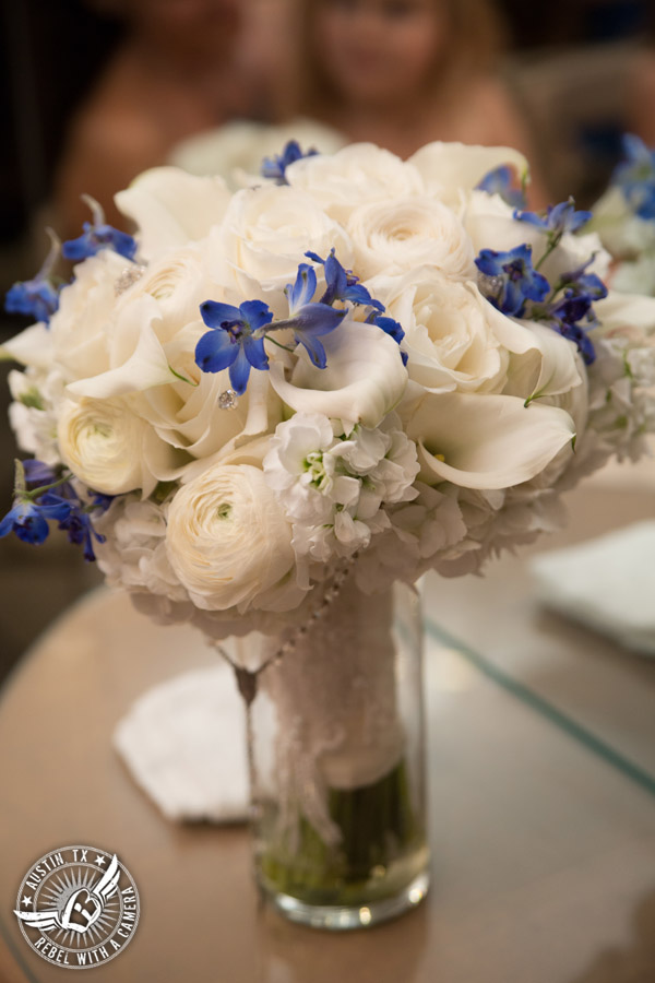 Picture of blue and white bridal bouquet with rosary by Flora Fetish for a wedding in Austin, Texas