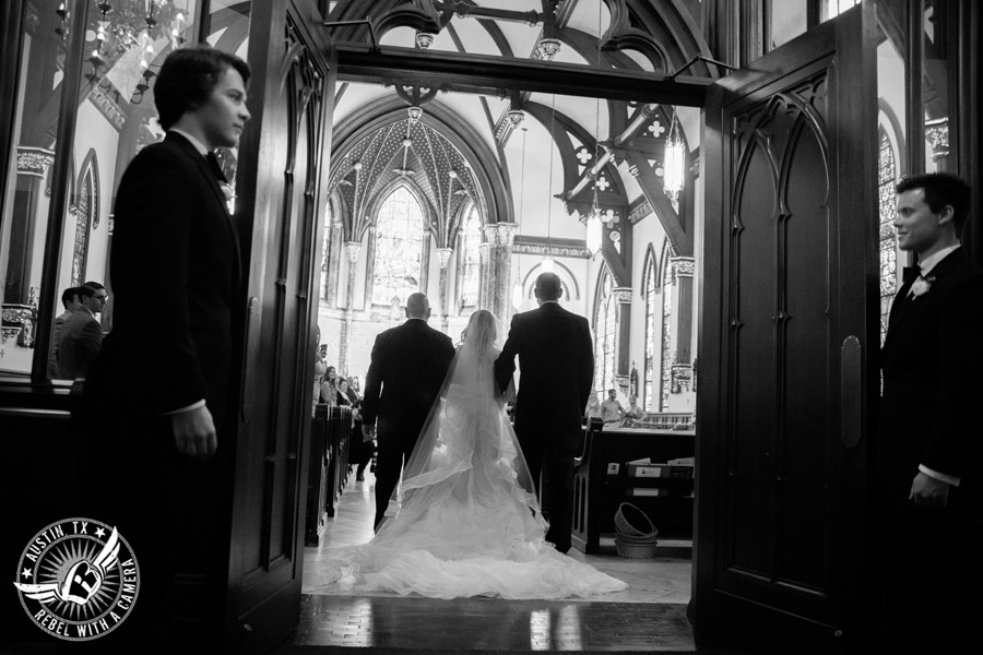 Picture of bride with dad walking down the aisle at wedding at St. Mary Cathedral in Austin, Texas
