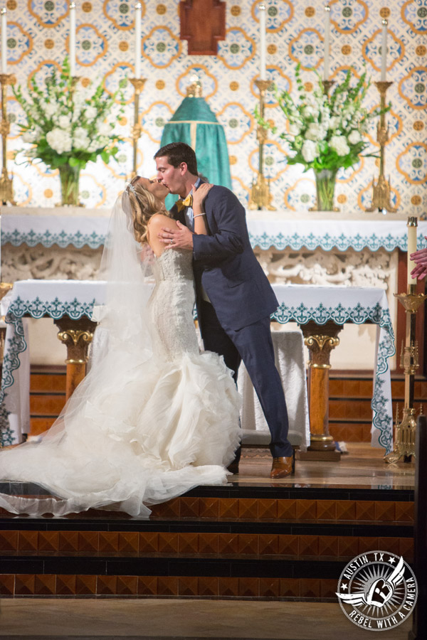 Picture of bride and groom kissing during wedding ceremony at St. Mary Cathedral in Austin, Texas