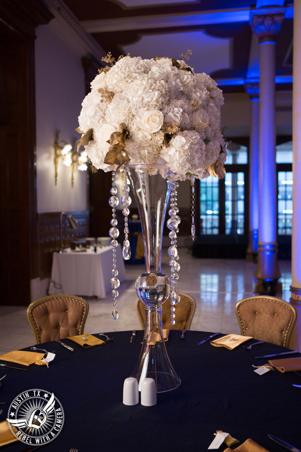 Picture of white floral table centerpieces with gold and crystals accents at wedding reception at Driskill Hotel mezzanine with florals by Flora Fetish