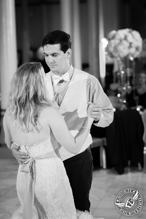 Bride and groom's first dance to the Grooves band at wedding reception at the Driskill Hotel in Austin, Texas