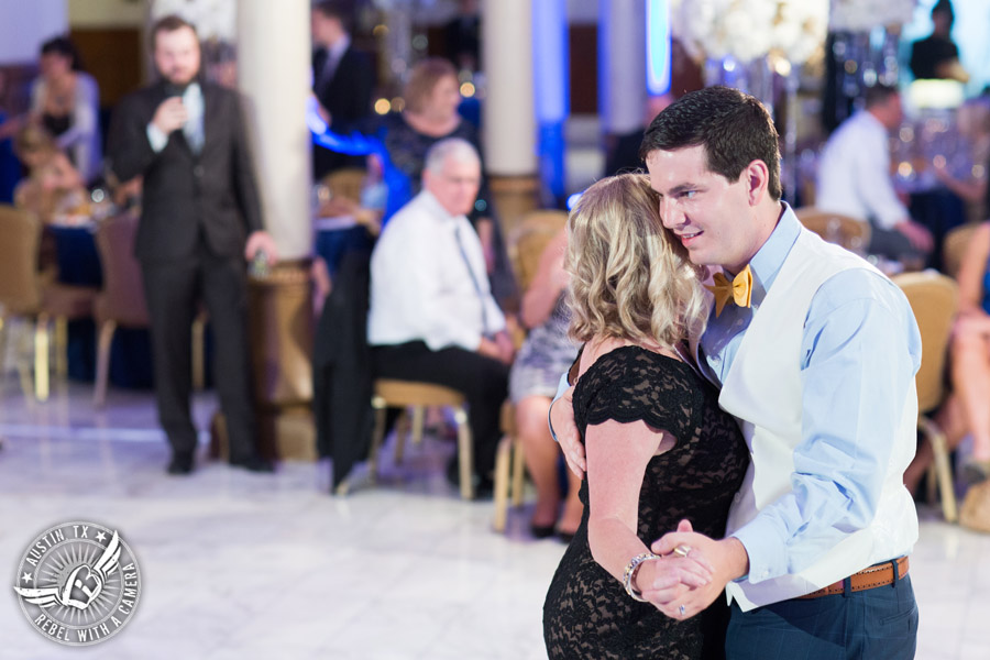 Picture of mother son dance to the Grooves band at wedding reception at the Driskill Hotel in Austin, Texas