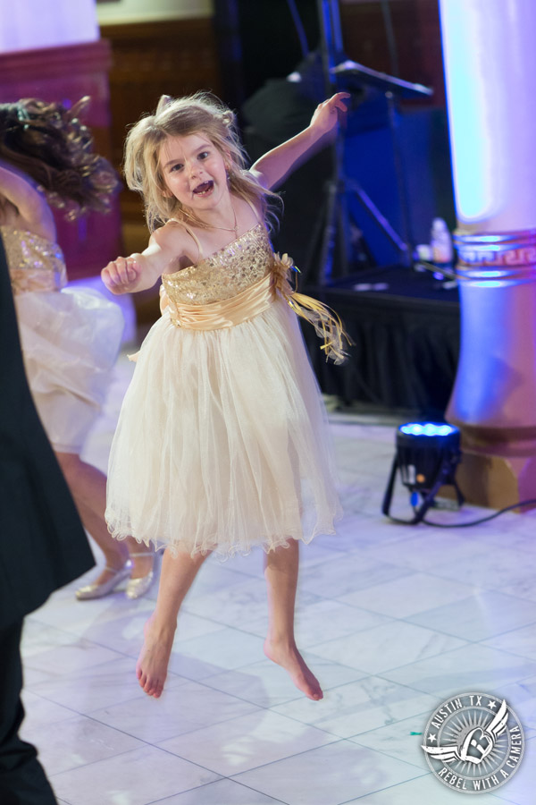 Picture of flower girl dancing to the Grooves band at wedding reception at the Driskill Hotel in Austin, Texas