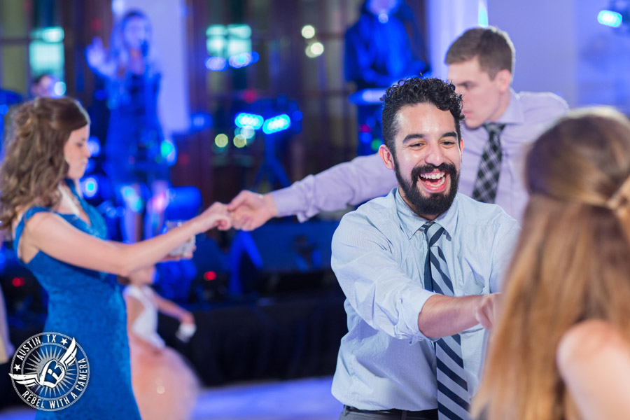 Picture of guests dancing to the Grooves band at wedding reception at the Driskill Hotel in Austin, Texas