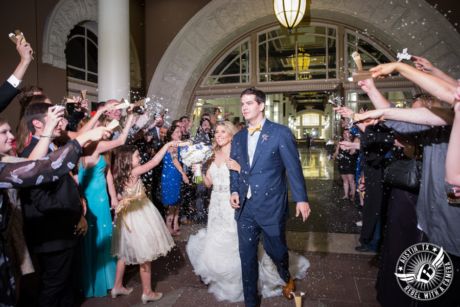Picture of bride and groom exiting wedding reception at the Driskill Hotel in Austin, Texas