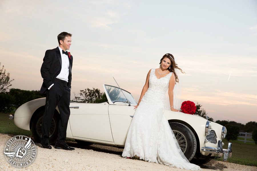 Taylor Mansion wedding photo of bride and groom with white convertible