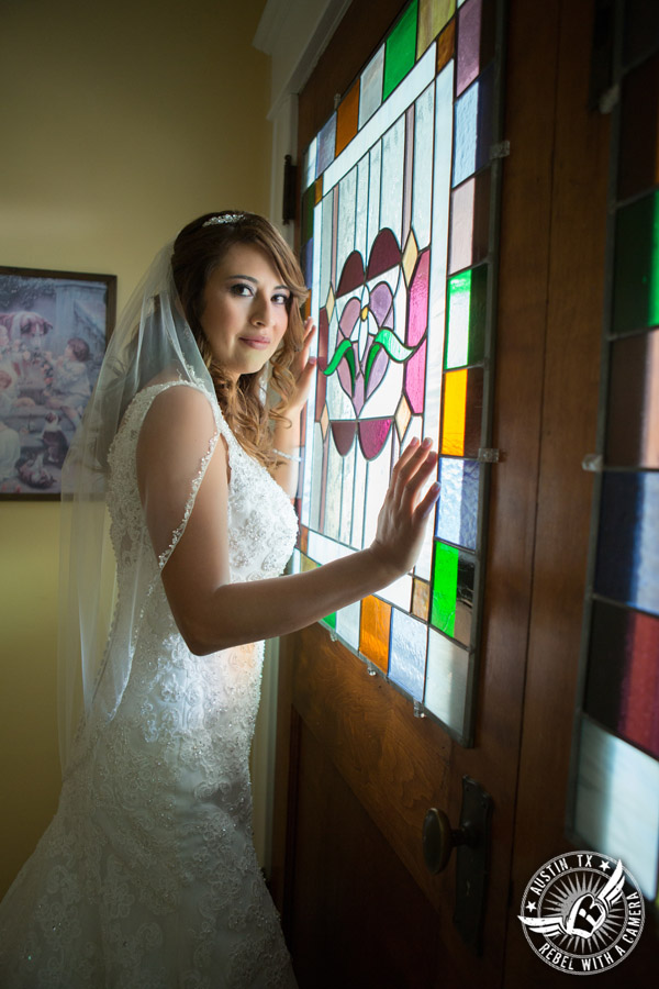Taylor Mansion wedding photo of bride and stained glass door