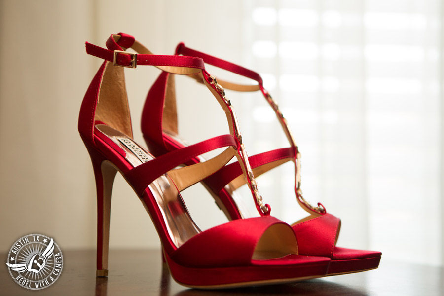 Taylor Mansion wedding photo of red high heel shoes for the bride in bride's room