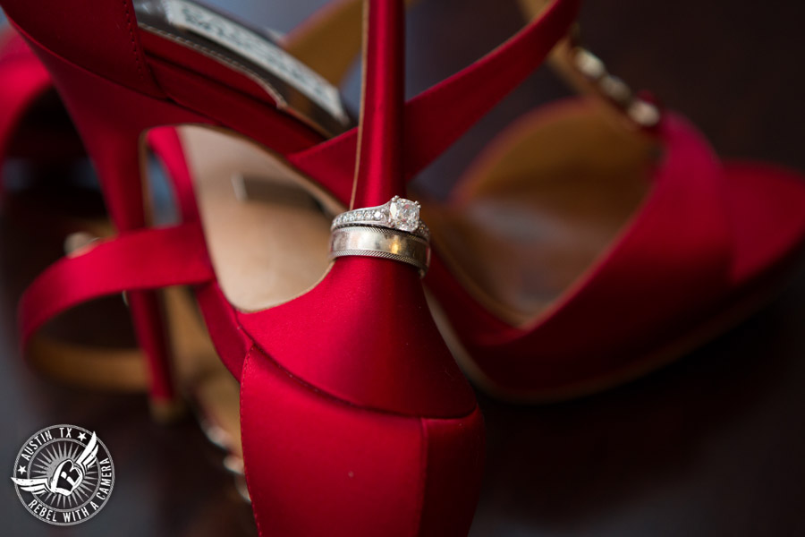 Taylor Mansion wedding photo wedding rings on red high heel shoes for the bride in bride's room
