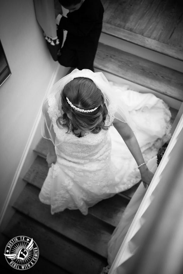 Taylor Mansion wedding photo bride coming down the stairs