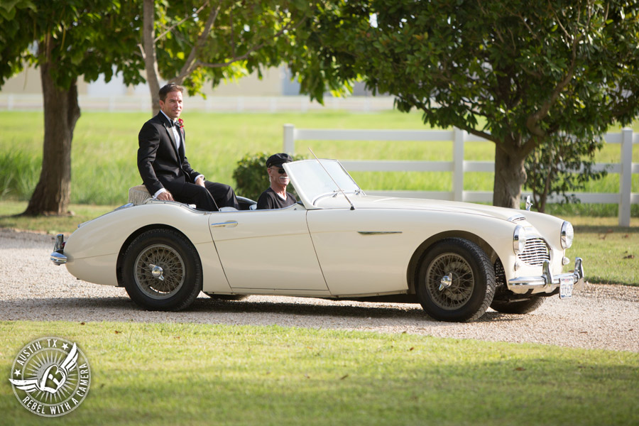 Taylor Mansion wedding photo groom rides white convertible to the wedding ceremony