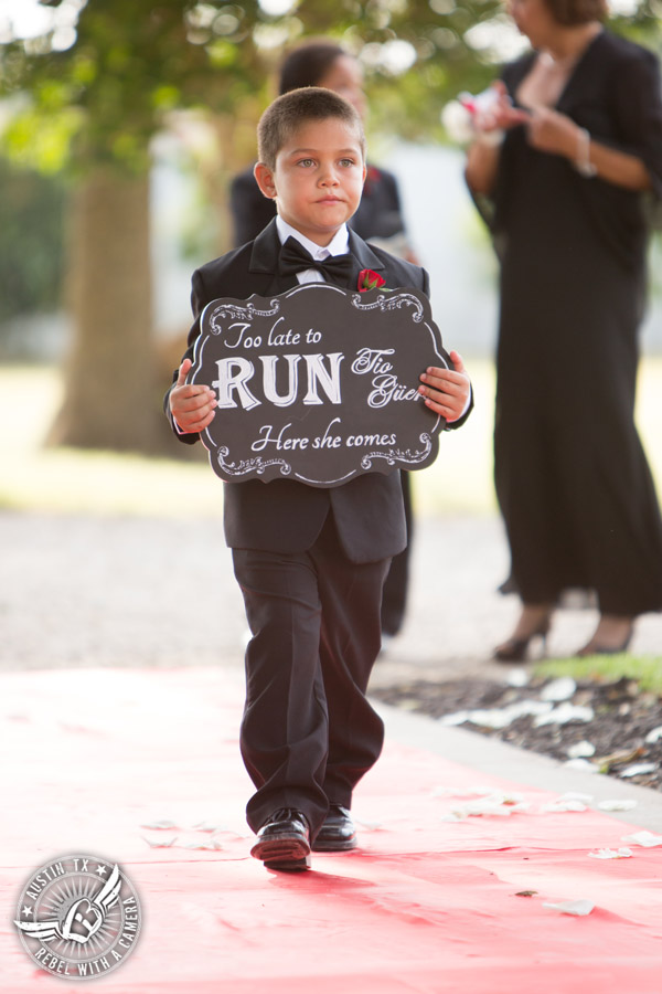Taylor Mansion wedding photo ring bearer walks down the aisle at wedding ceremony