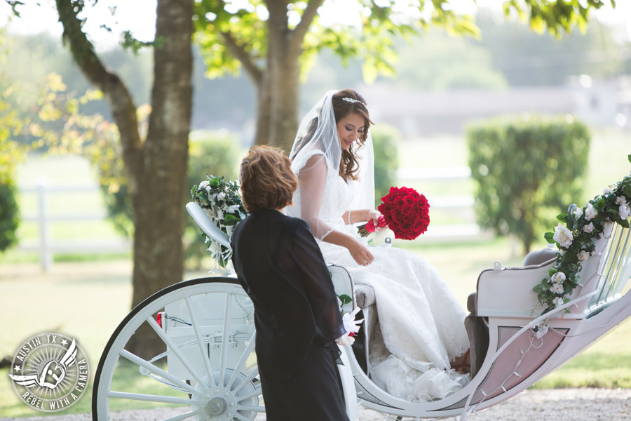 Taylor Mansion wedding photo bride gets off Angeli Carriage at wedding ceremony