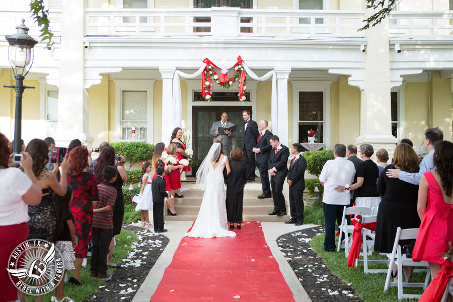 Taylor Mansion wedding photo bride walks down the aisle with mother at wedding ceremony