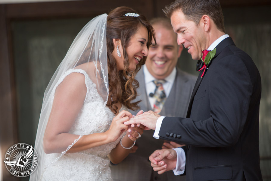Taylor Mansion wedding photo of bride putting ring on groom's finger at wedding ceremony