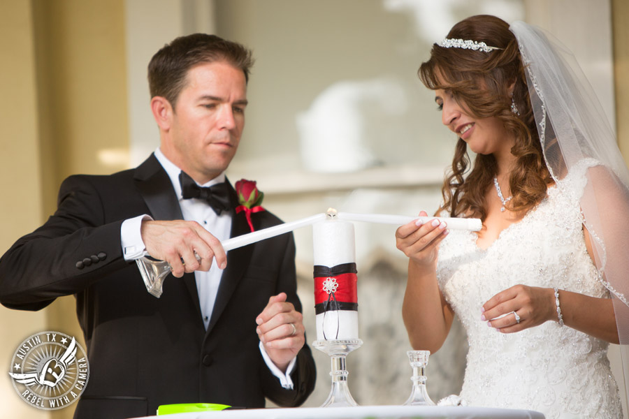 Taylor Mansion wedding photo of bride and groom lighting unity candle at wedding ceremony