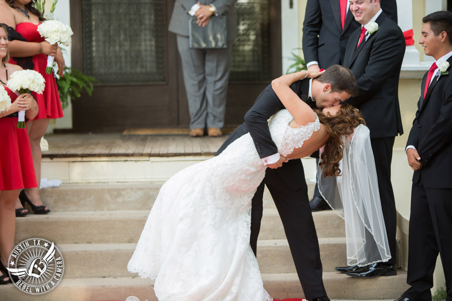 Taylor Mansion wedding photo of bride and groom kiss at wedding ceremony