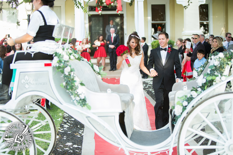 Taylor Mansion wedding photo of bride and groom walk down the aisle at wedding ceremony to Angeli Carriage