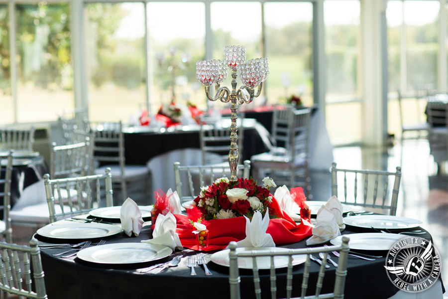 Taylor Mansion wedding photo of candelabra centerpiece on table with silver chiavari chairs in Crystal Ballroom
