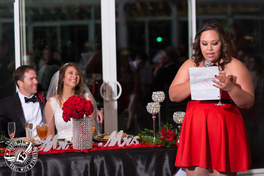 Taylor Mansion wedding photo maid of honor giving toast to bride and groom in Crystal Ballroom