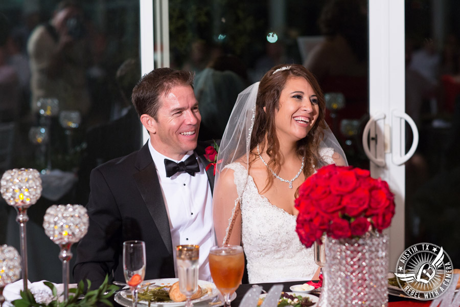 Taylor Mansion wedding photo bride and groom laugh during toasts in Crystal Ballroom