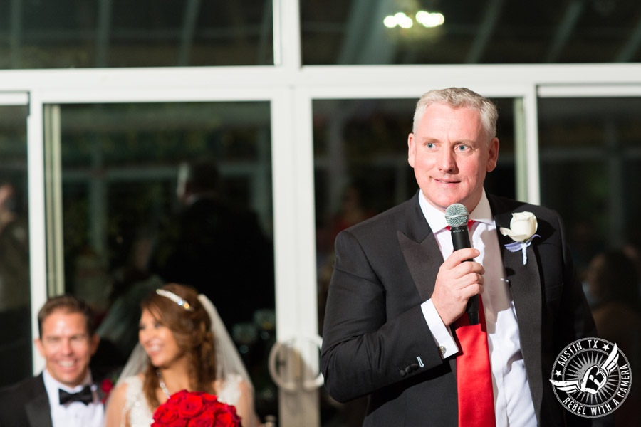 Taylor Mansion wedding photo best man giving toast to bride and groom in Crystal Ballroom