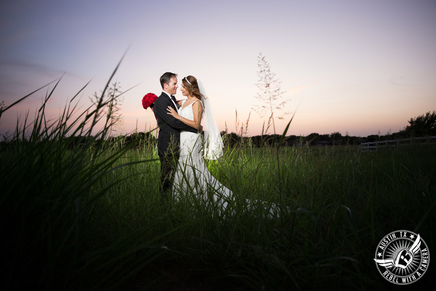 Taylor Mansion wedding photo of bride and groom in field at sunset
