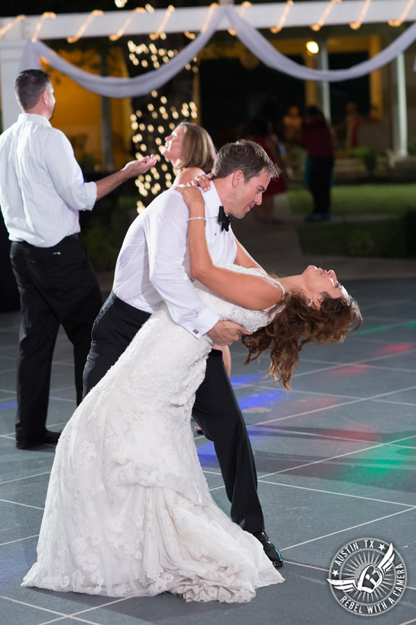Taylor Mansion wedding photo bride and groom dance on the patio with 1st Class Entertainment DJ Jason