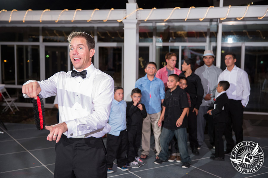 Taylor Mansion wedding photo groom throws the garter on the patio with 1st Class Entertainment DJ Jason