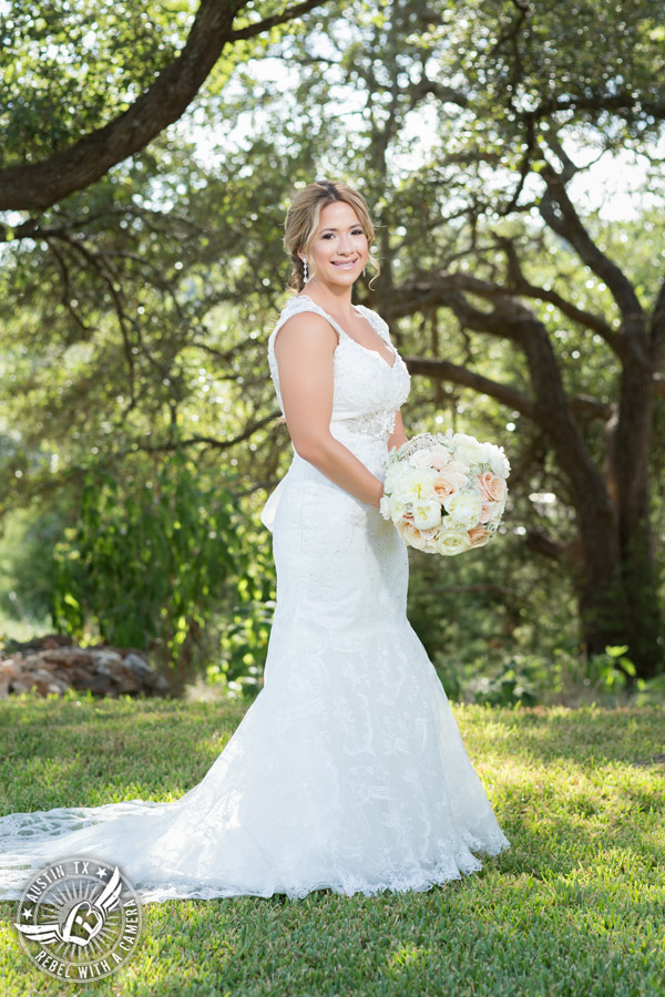 Gabriel Springs bridal portrait in Georgetown, Texas, with hair and makeup by Kiss by Katie and bouquet by Sixpence Floral Design at the Springs Events