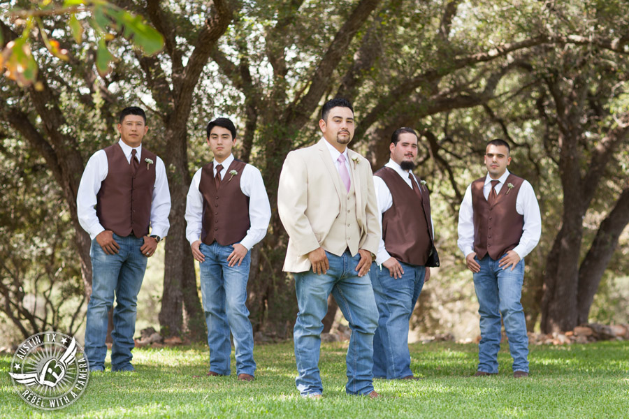Romantic wedding pictures at The Springs Events in Georgetown, Texas - Gabriel Springs - dramatic groom and groomsmen in tan jacket and brown vests