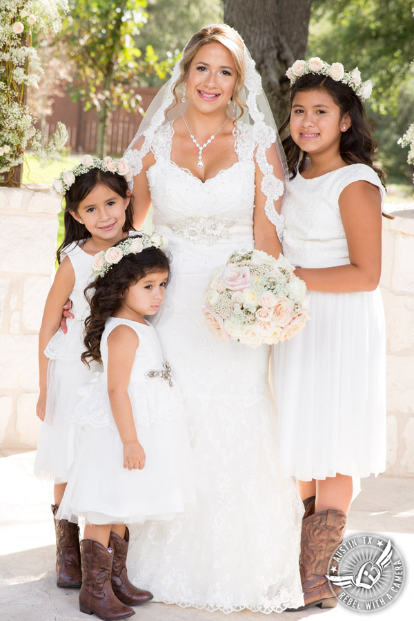 Romantic wedding pictures at The Springs Events in Georgetown, Texas - Gabriel Springs - happy bride and flower girls in white dresses and brown cowboy boots