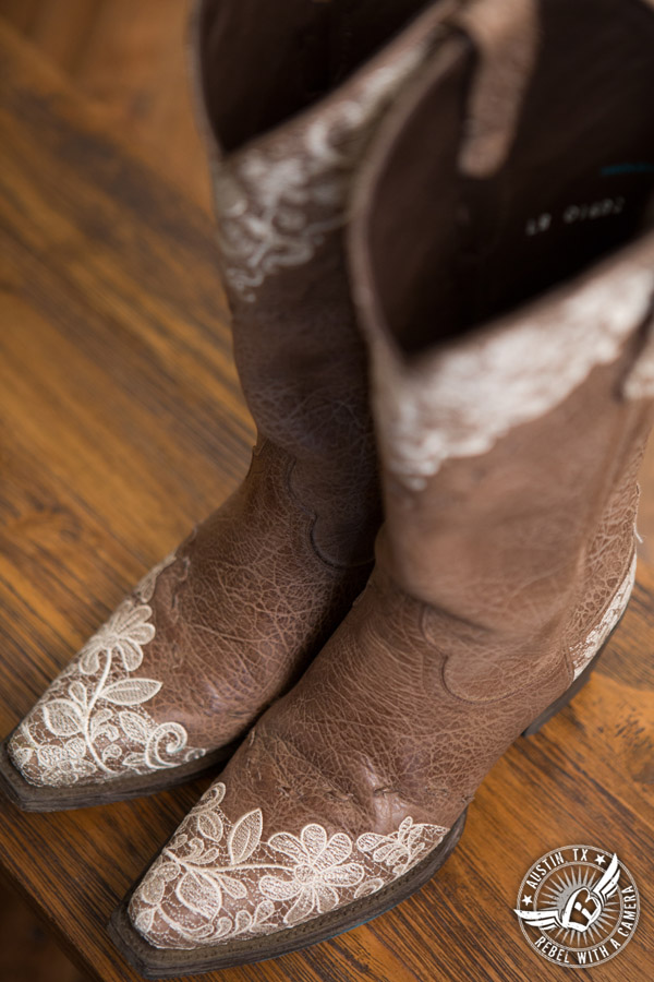 Romantic wedding pictures at The Springs Events in Georgetown, Texas - Gabriel Springs - lace covered cowboy boots for the bride