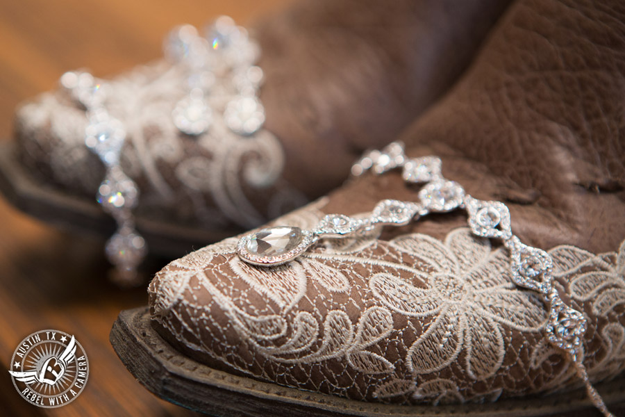 Romantic wedding pictures at The Springs Events in Georgetown, Texas - Gabriel Springs - bridal jewelry on lace covered cowboy boots for the bride