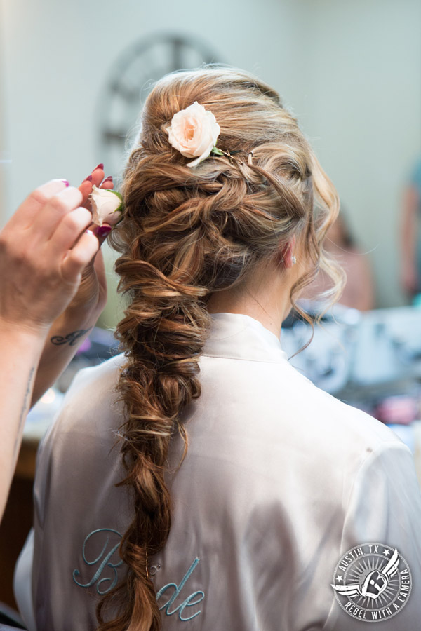 Romantic wedding pictures at The Springs Events in Georgetown, Texas - Gabriel Springs - Kiss by Katie does bride's hair in the bride's room
