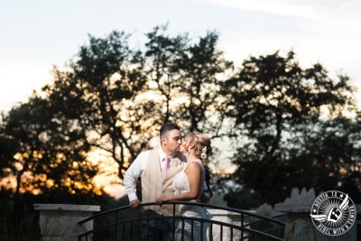 Romantic wedding pictures at The Springs Events in Georgetown, Texas - Gabriel Springs - bride and groom kiss on bridge